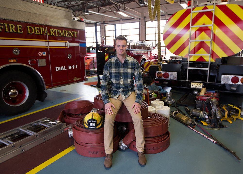 a male student sitting in the firehouse